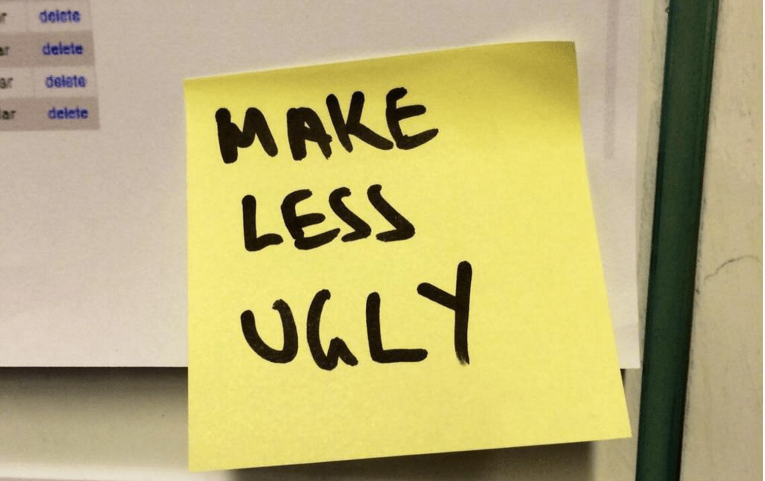 a yellow sticky note attached to a computer screen with handwriting on it that says