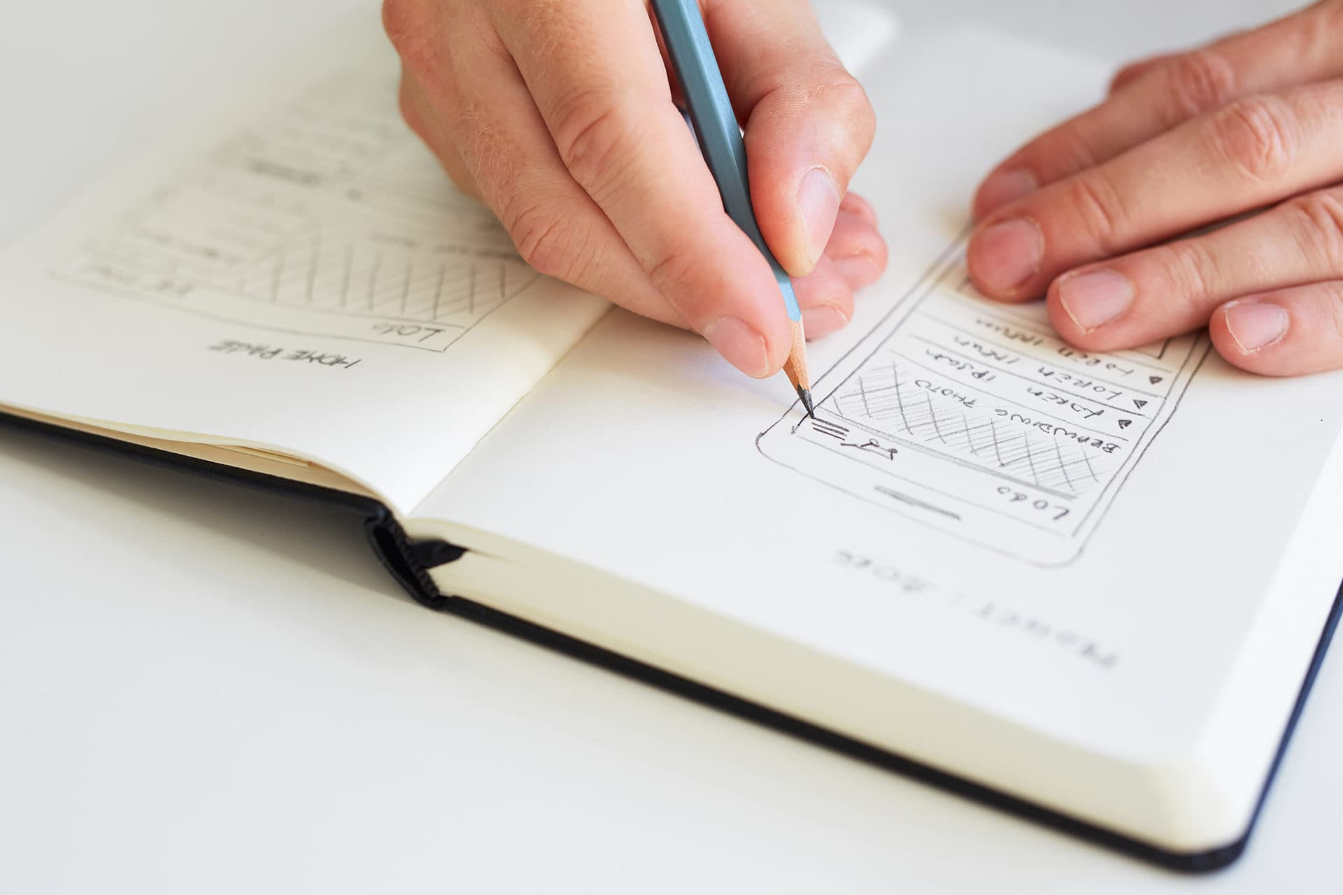person sketching in a book