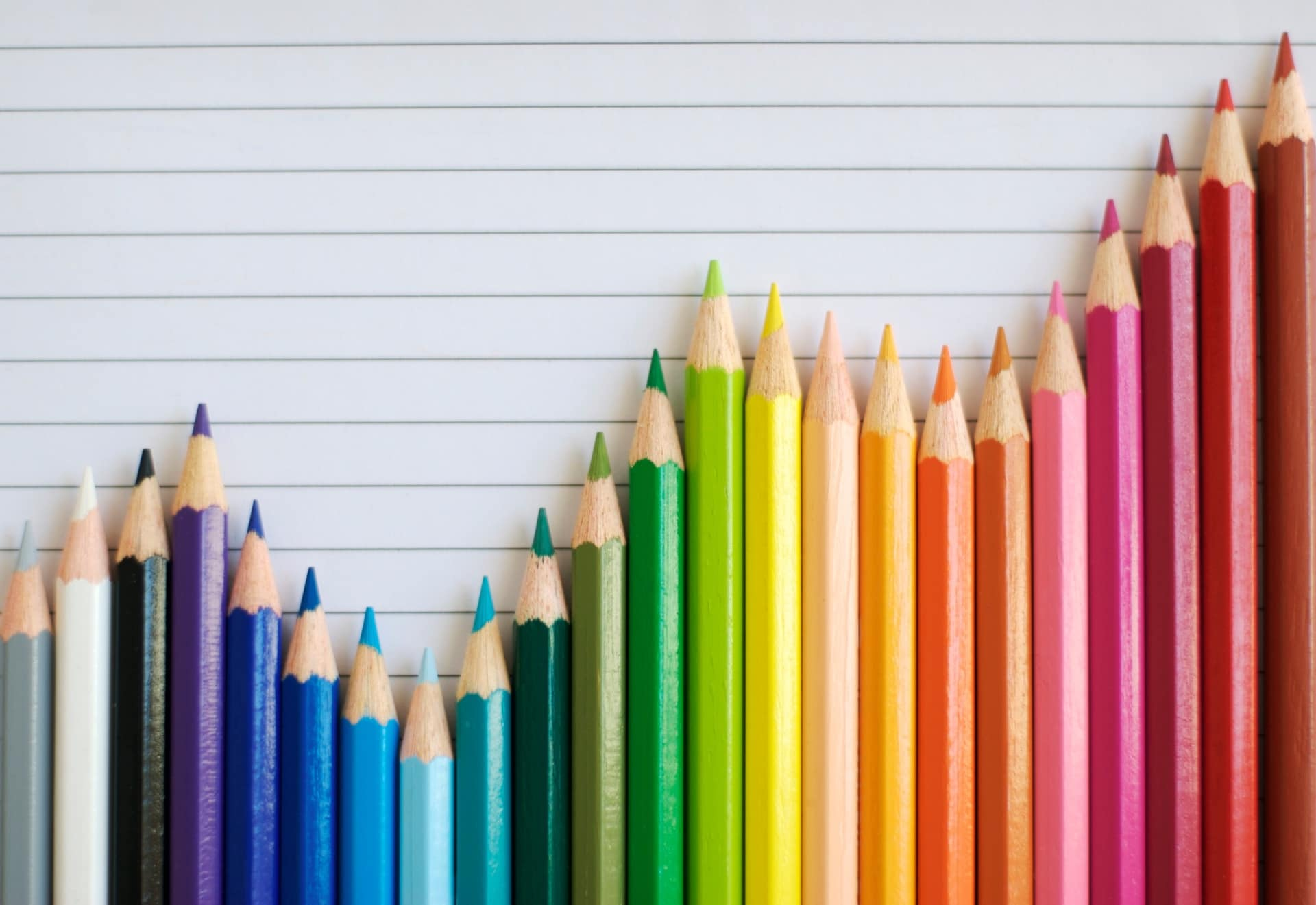 a group of colored pencils arranged in the form of a line graph