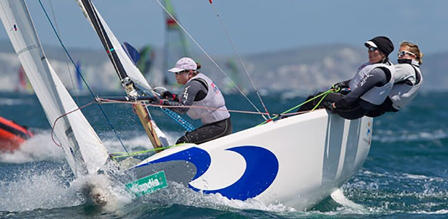 team of people racing a sailboat